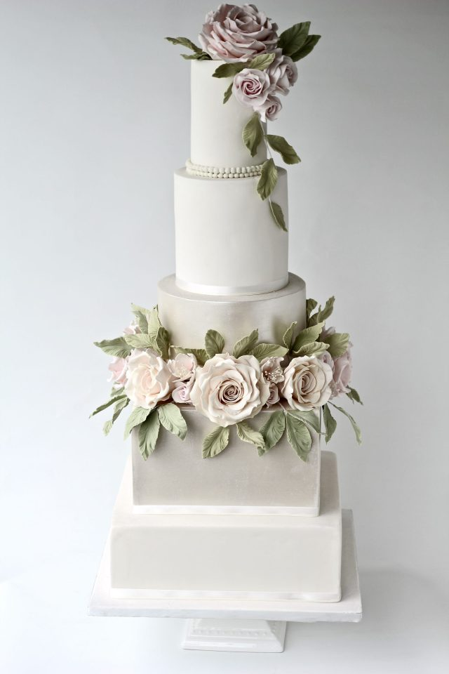 five tier wedding cake with blush pink roses in a ivory and pearl shimmer