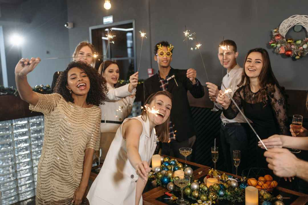a team holding sparklers and having a celebration in the office