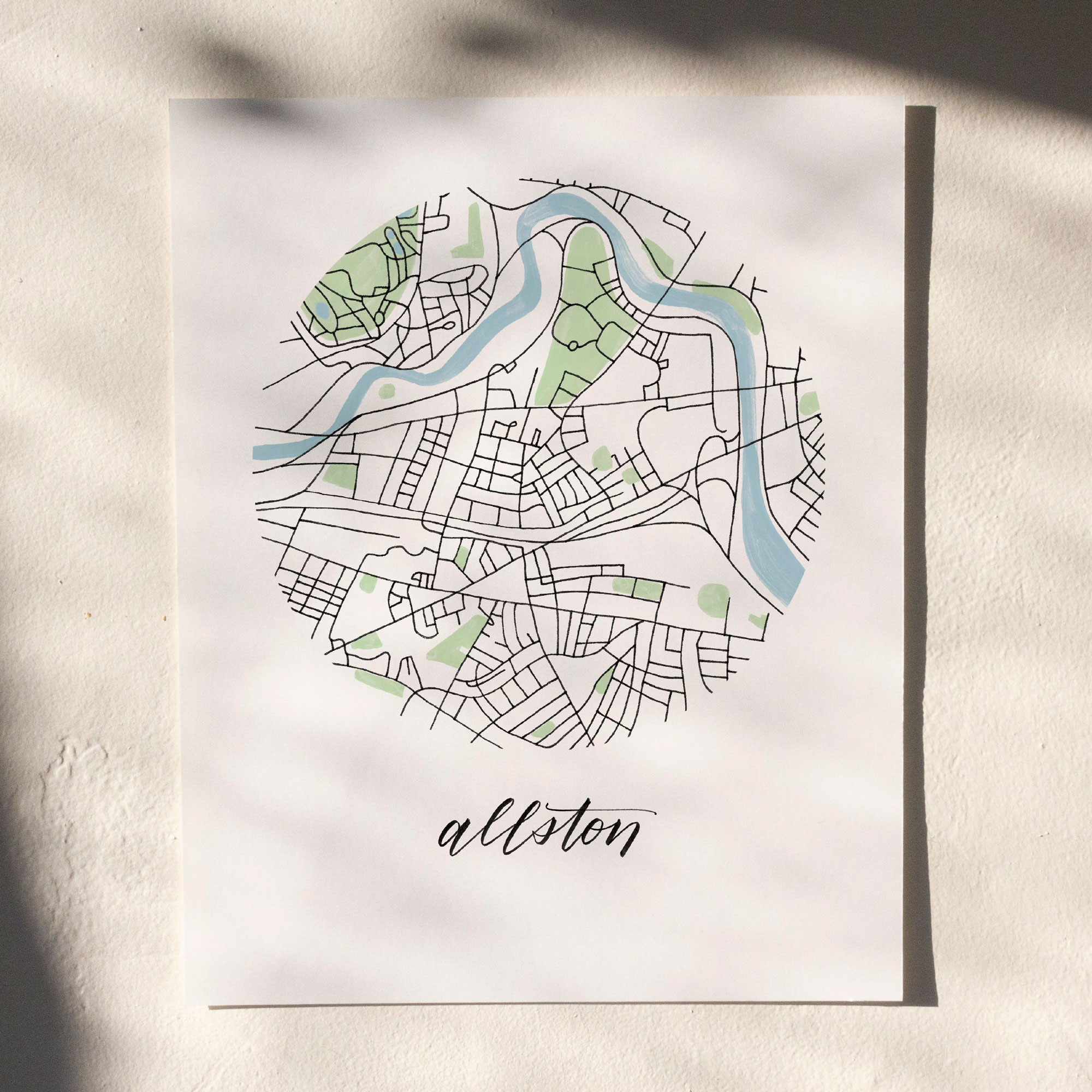 Allston, Boston Map Print hanging on white wall with leaf shadows across the image