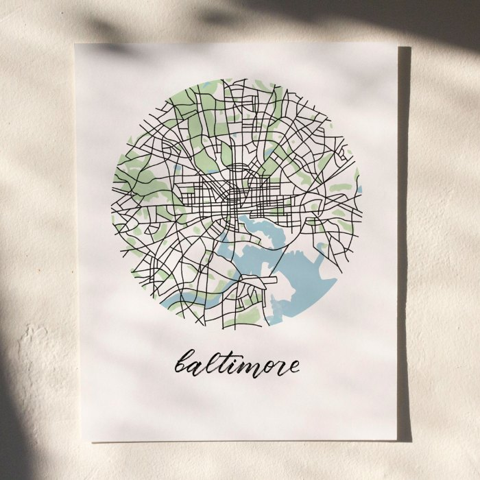 Baltimore Map Print hanging on white wall with leaf shadows across the image