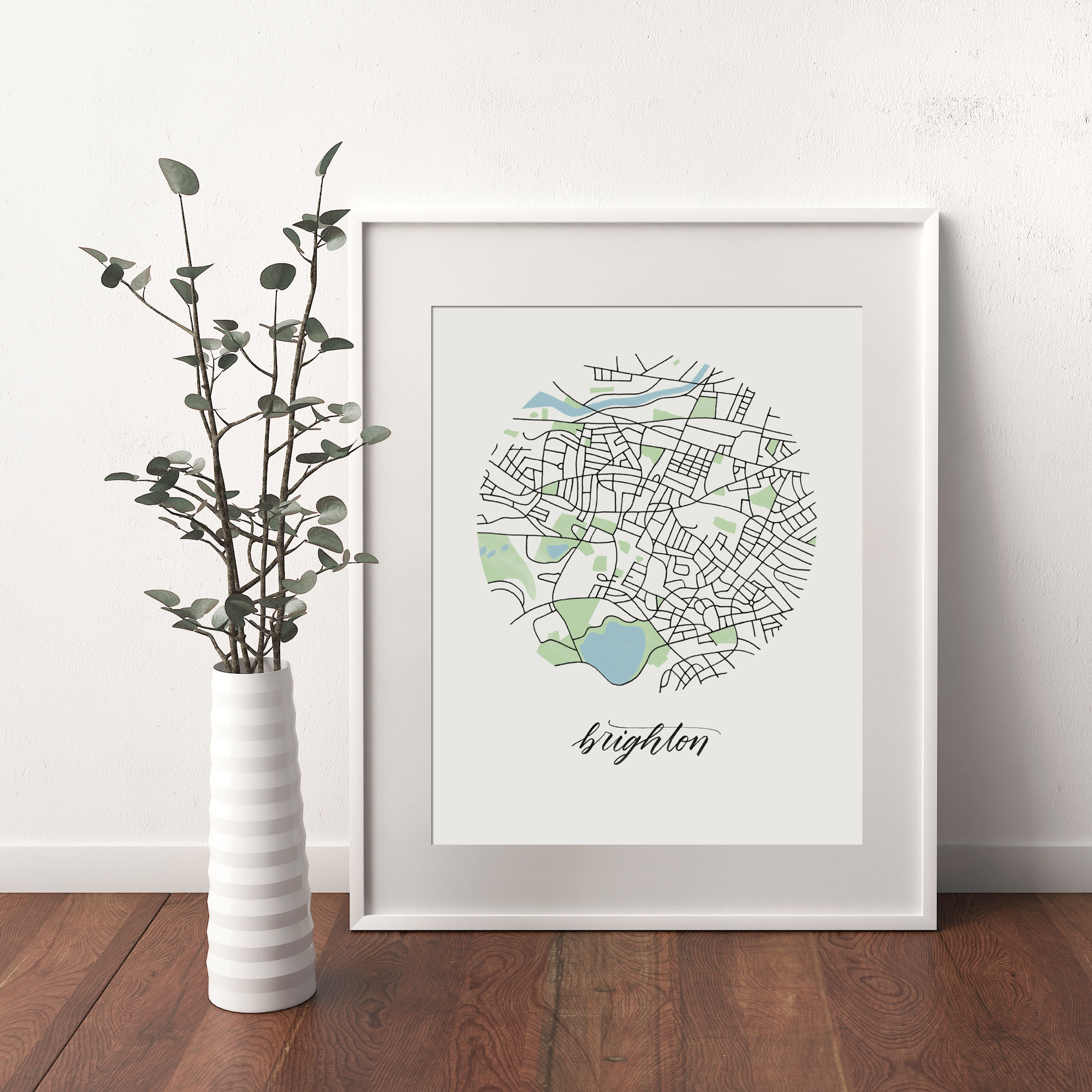 Brighton, Boston Map print framed and leaning on white wall next to dried leaves in a vase