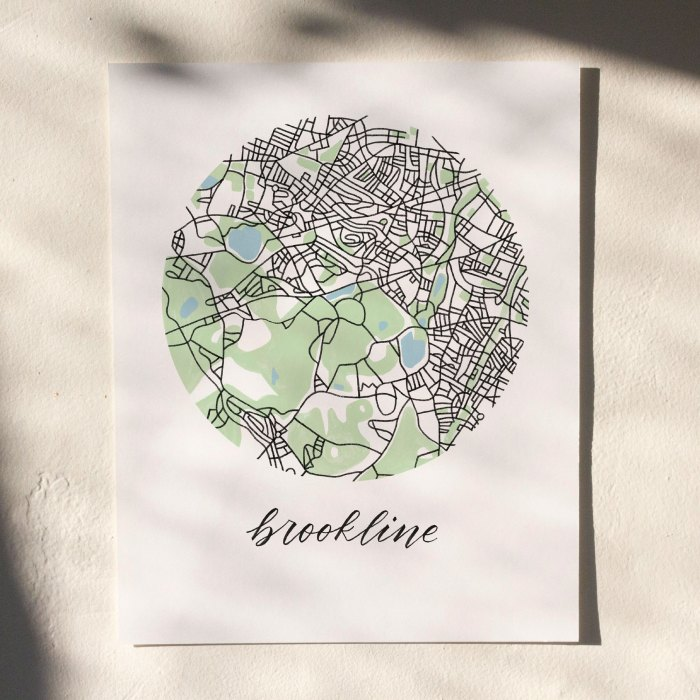 Brookline, Boston Map Print hanging on white wall with leaf shadows across the image