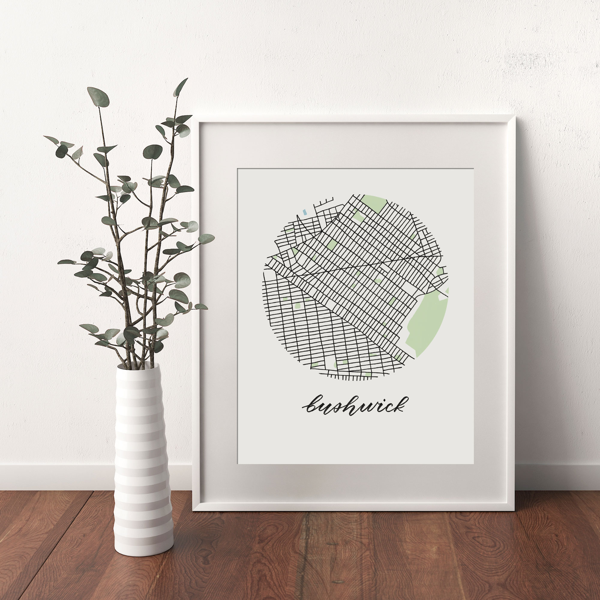 Bushwick, Brooklyn Map print framed and leaning on white wall next to dried leaves in a vase