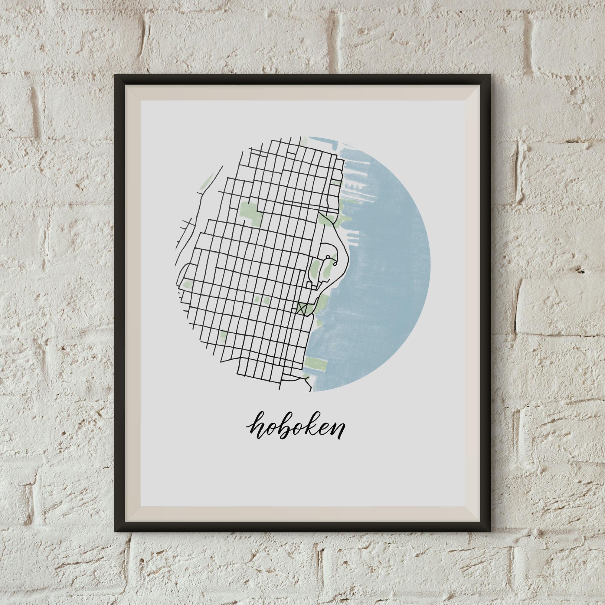 Hoboken Map Print framed on a white brick wall