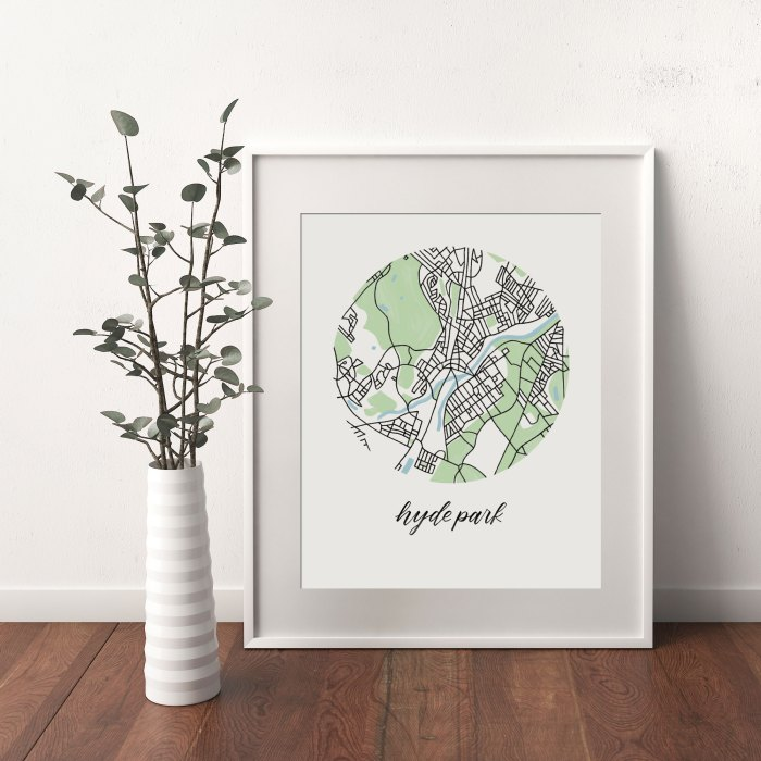 Hyde Park Map, Boston print framed and leaning on white wall next to dried leaves in a vase