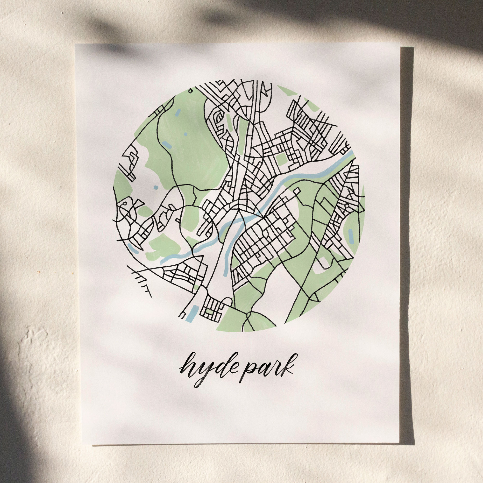 Hyde Park, Boston Map Print hanging on white wall with leaf shadows across the image