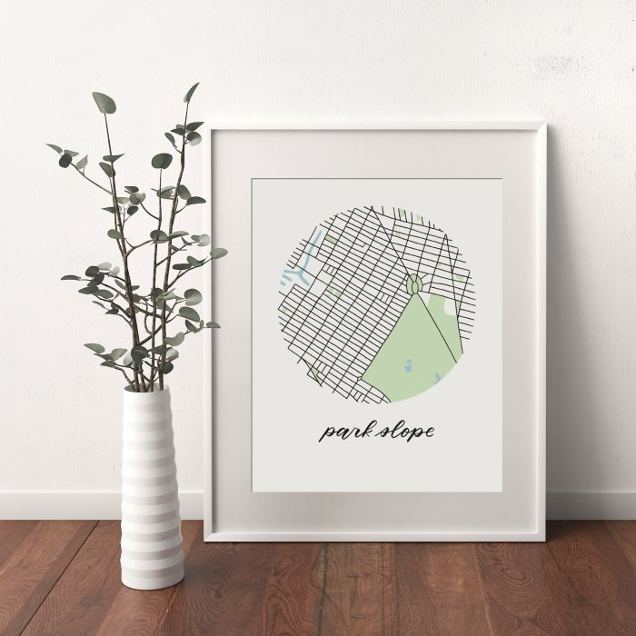 Park Slope, Brooklyn Map print framed and leaning on white wall next to dried leaves in a vase