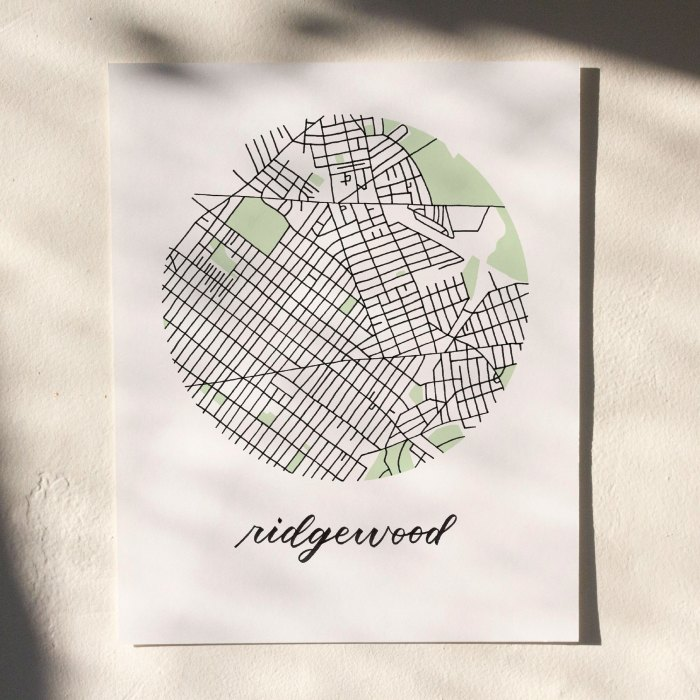 Ridgewood, Queens Map Print hanging on white wall with leaf shadows across the image
