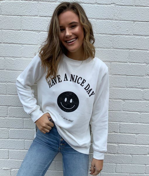 white sweater smiley face