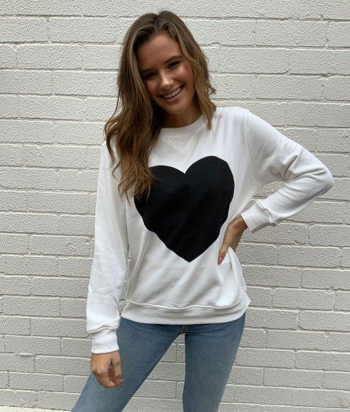 white sweater black heart