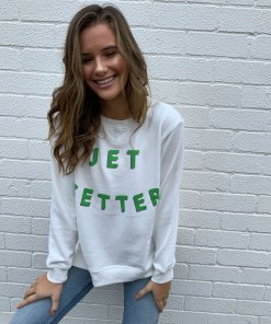 white sweater jetsetter