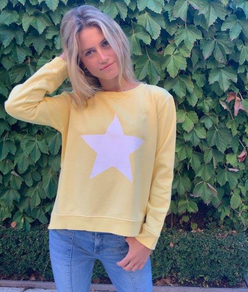 yellow sweater white star