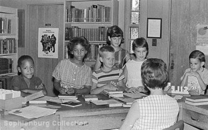 Photo: School children at the front desk in Emmie Seele Faust Memorial Library, corner of Coll and Magazine, circa 1965.