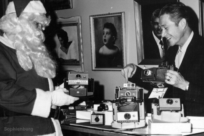 Photo: Rudy Seidel and Santa inside camera shop.
