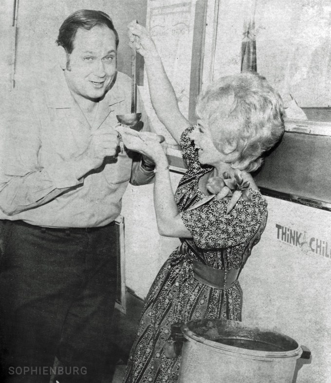"""Photo caption: New Braunfels Chamber of Commerce President Herb Skoog getting a taste of """"York Creek Barn Chili"""" from the Queen of the 2nd Annual Chilympiad in San Marcos, Mrs. Bill (Barbara) Castlebury. Photo from the NB Herald-Zeitung Negatives Collection, September 16, 1971."""