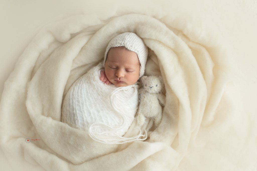 Sophie Lecavalier Photography, SophiePhoto  sleeping newborn baby wrapped in white with soft fluffy blanket swirl around her