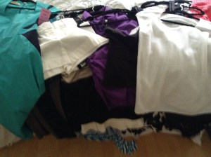 money challenge sophisticated spenders pile of clothes with tags