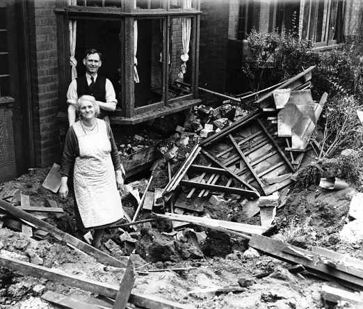 A Coventry couple photographed by the press smiling showing the Nazi's that the Coventry spirit was not broken!