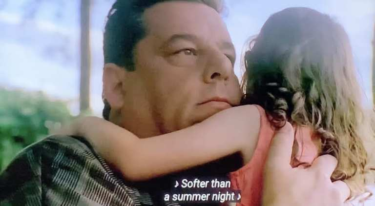 Bobby Baccalieri holding his daughter Nica in Soprano Home Movies