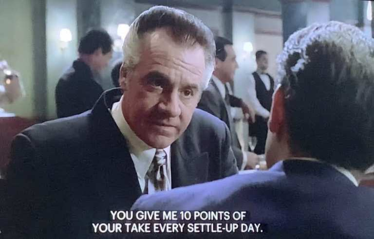 Paulie Walnuts talking to Christopher after his making ceremony.