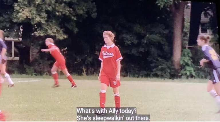 Ally is walking slowly during the soccer game with Meadow Soprano