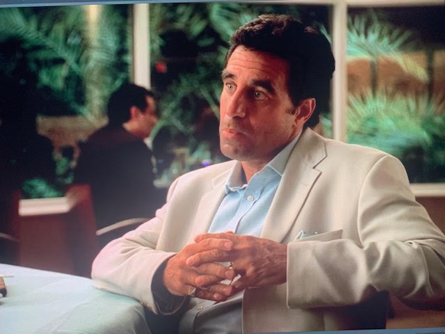 Little Carmine Lupertazzi is in Miami at a bar talking business with Tony Soprano.