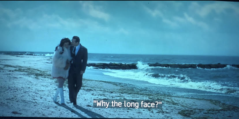 giuseppina and dickie moltisanti are walking along the beach.