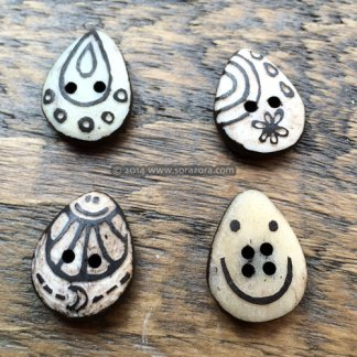 Water drop shaped buttons