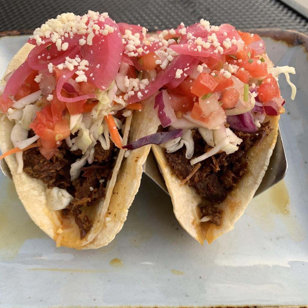 Tacos with pickled onion, beef, cheese on corn tortilla