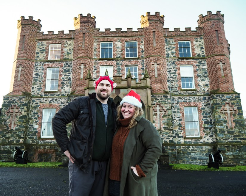 Sorcha and Matt in front of our friends castle on Christmas Day