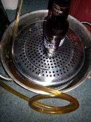 filling bottles with homebrew beer