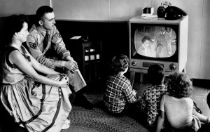 The parents look at television. The children watch television.