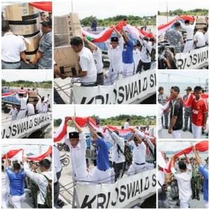 Gotong royong mengangkut bendera 10 Km ke KRI OWA 354, antara peserta yang terlibat dan prajurit TNI AL disaksikan oleh Danlanal Nunukan