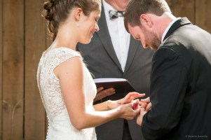 exchanging of the rings at a backyard wedding ceremony by Sorrells Photography