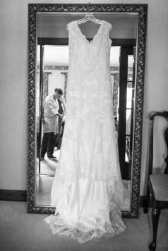 Bride with wedding dress by Sorrells Photography
