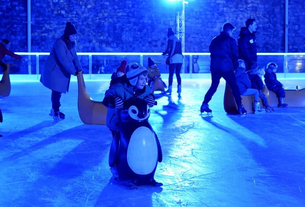 ice skating with children at the tower of london