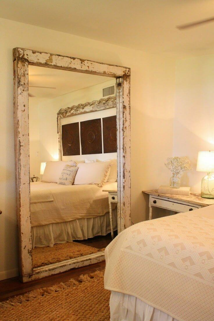 Rustic bedroom decor - Large Rustic Mirror Next to the Bed