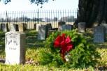 Wreaths Across America and dozens of volunteers laid evergreen wreaths at headstones.