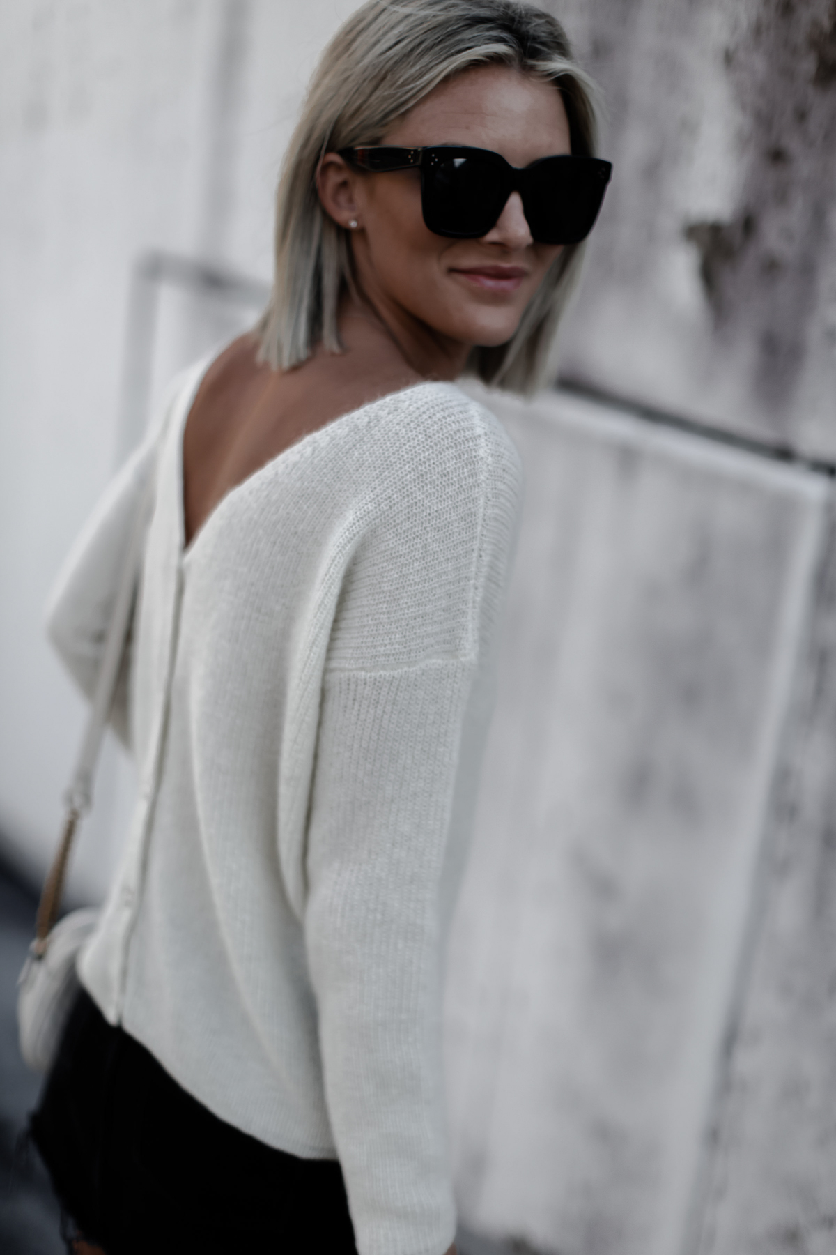 A classic cream sweater on blogger So Sage