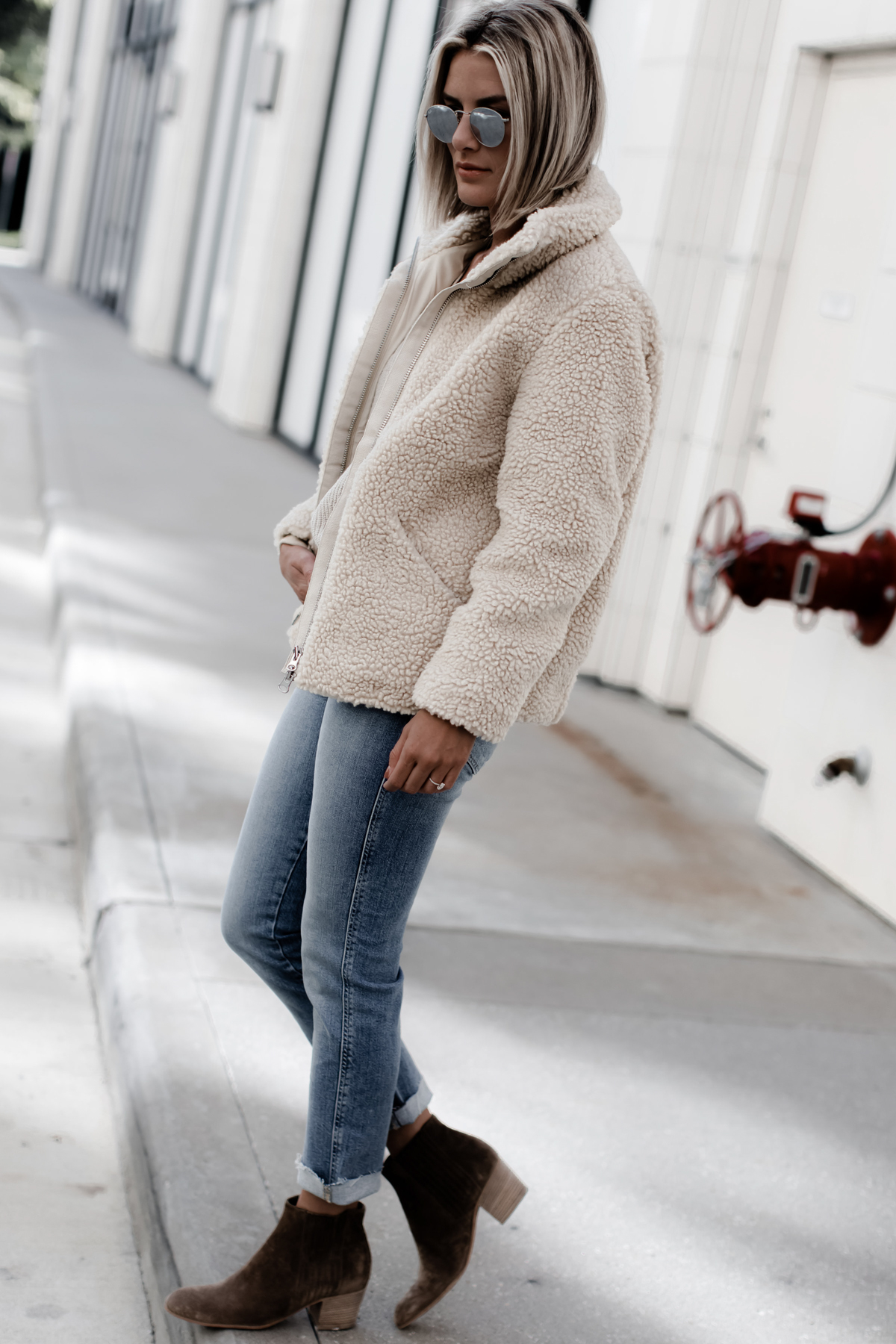 a cream colored pile teddy jacket on blogger So Sage