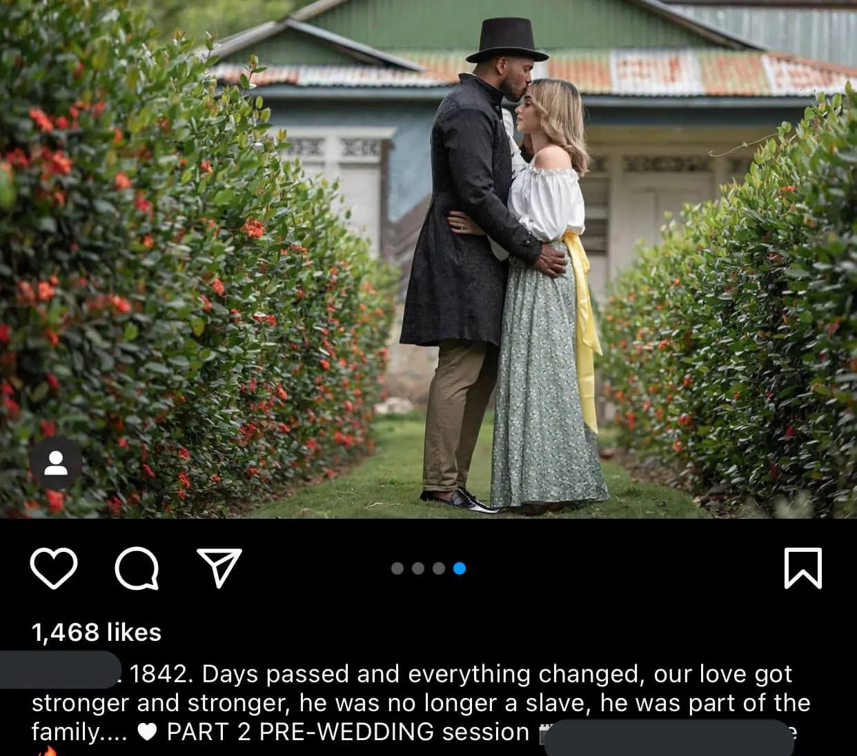 A picture of a Black man holding a White woman in an Antebellum-style photo.