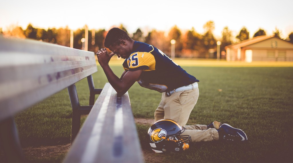 teeen football player wanting to win