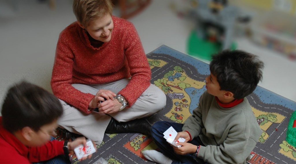 Mom playing cards with kids