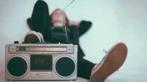 Teen listening to old-fashioned radio