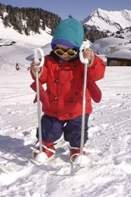 Little boy on baby skis