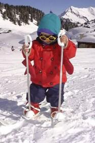 Little boy on baby skis