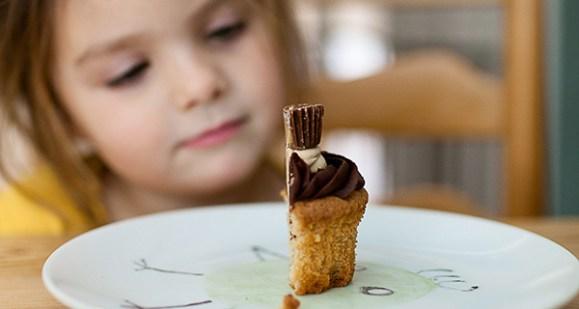 Girl eyeing cupcake