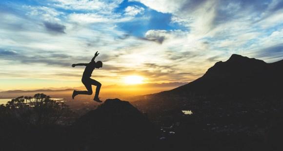 Teen jumping horizon