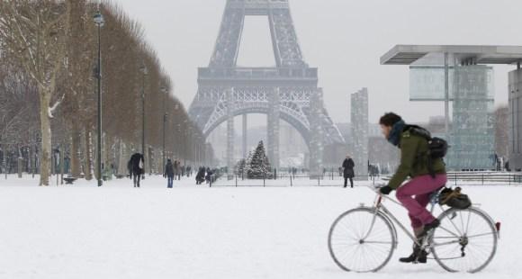 Biker in Paris in the snow