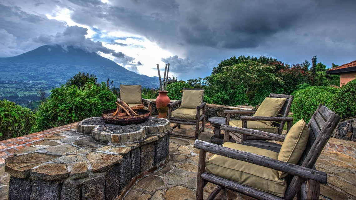 rwanda-volcanoes-virunga-lodge-randazoo-outdoor-seating-with-view-and-fire